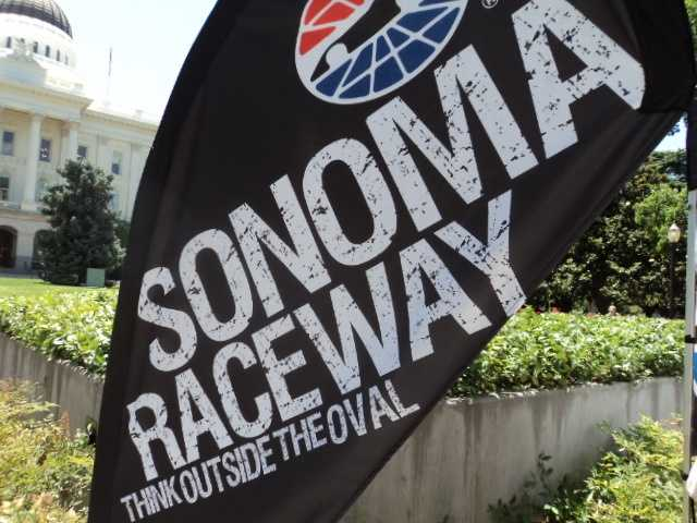 """Spectators were encouraged by Sonoma Raceway signs to """"Think Outside the Oval."""""""