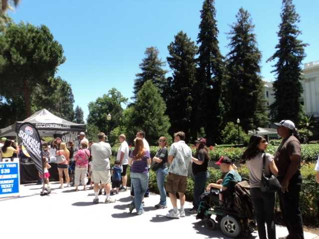 NASCAR fans of all ages lined up in front of the state Capitol for their chance to spin the Sonoma Raceway prize wheel.