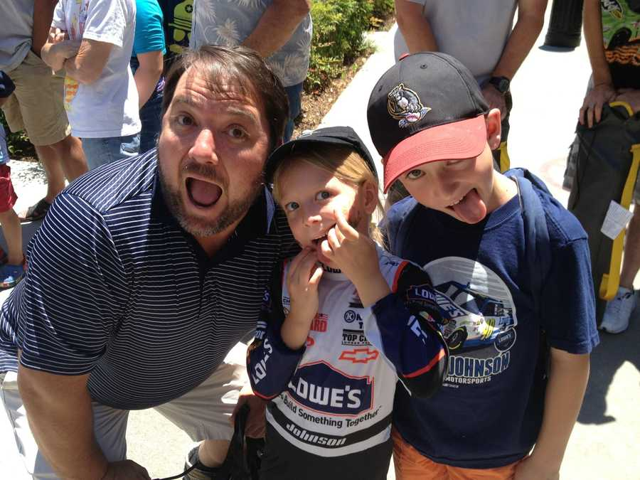 This family of Jimmie Johnson fans celebrates NASCAR Day in Sacramento by enjoying time together at the Hauler Parade.