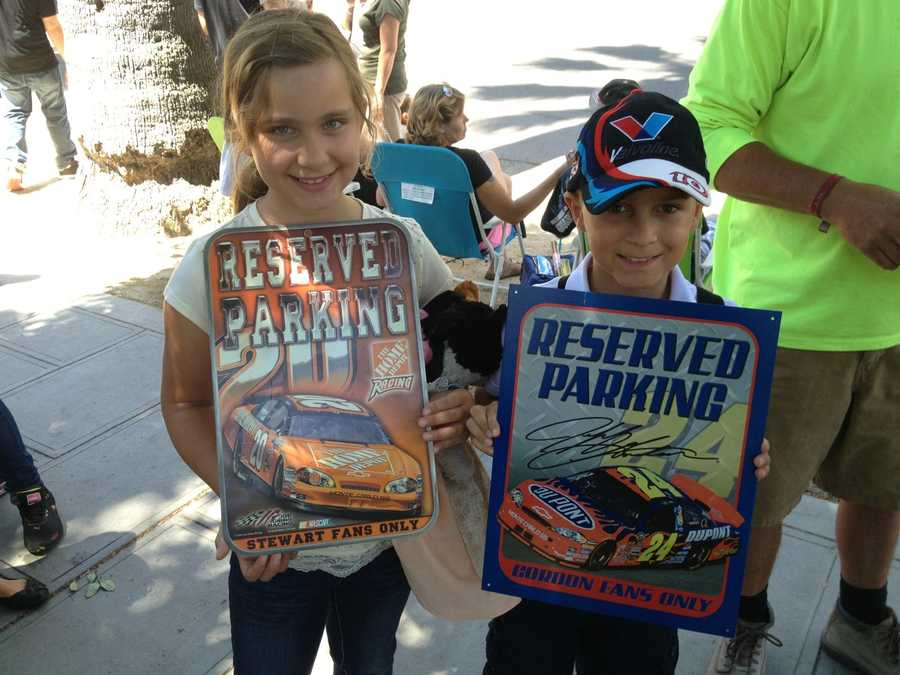 These siblings show their signs on the streets of downtown to celebrate NASCAR Day and Sonoma's upcoming race.
