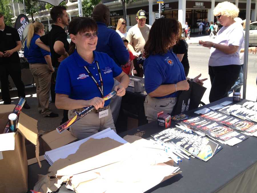 Track ambassadors hand out Sonoma Raceway posters, reusable bags, pens and other freebies to NASCAR fans.