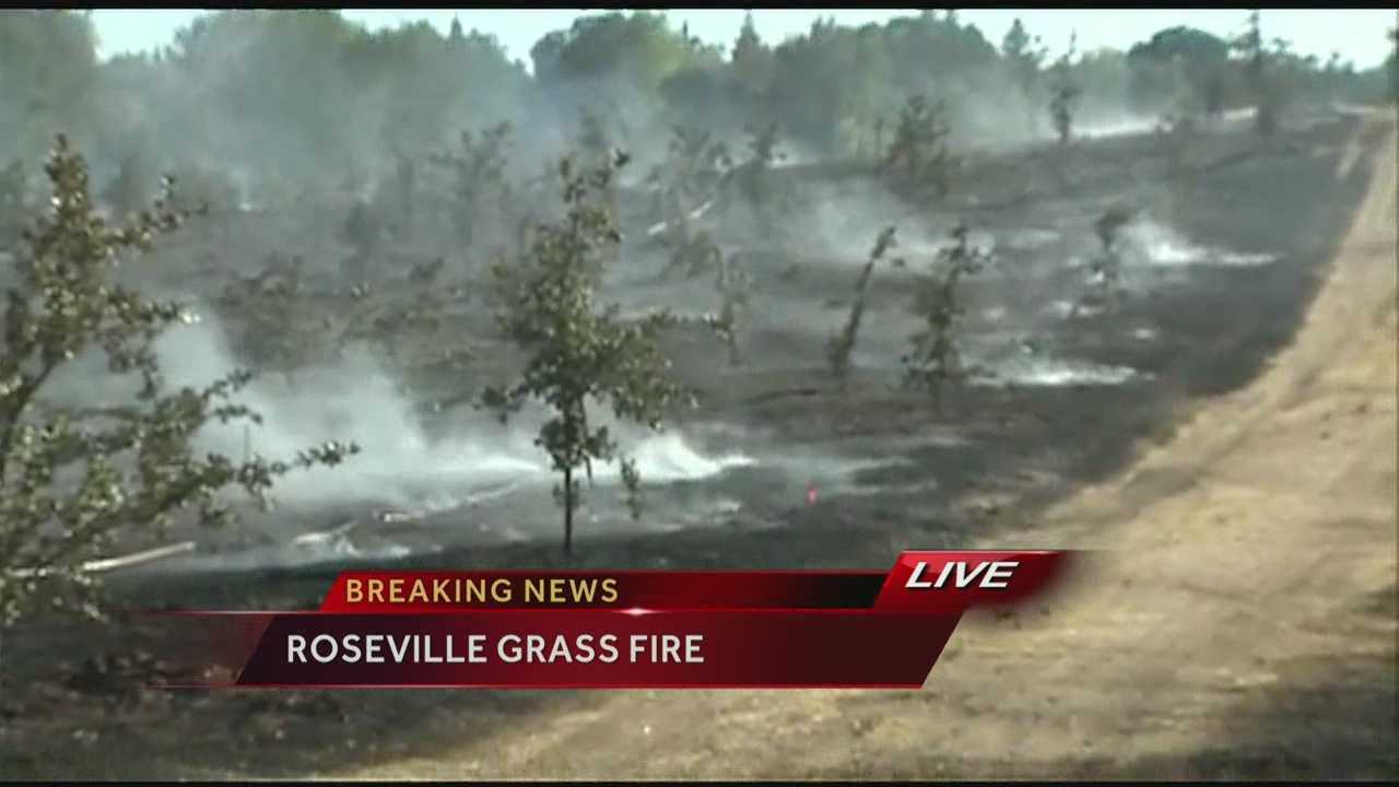 """A firefighters continue to control a grass fire in Roseville that is considered """"suspicious"""" by Roseville Police."""