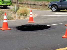 The sinkhole is about 8 feet in diameter.