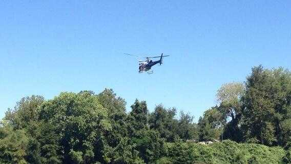 Sacramento Fire uses a CHP chopper to drop rescuers into the Sacramento River during training (June 28, 2013).