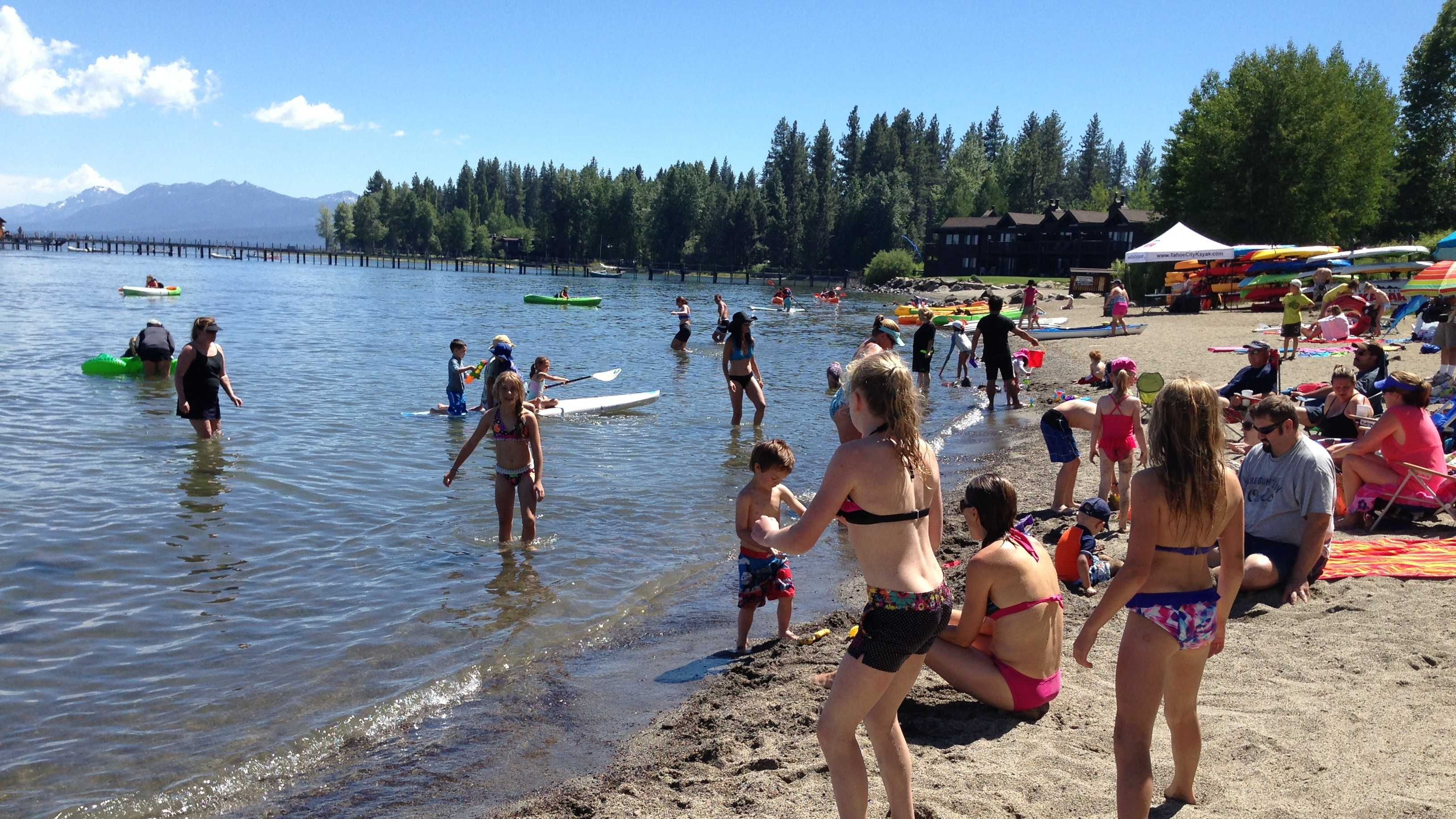 Swimmers and sunbathers enjoy Commons Beach in Tahoe City.