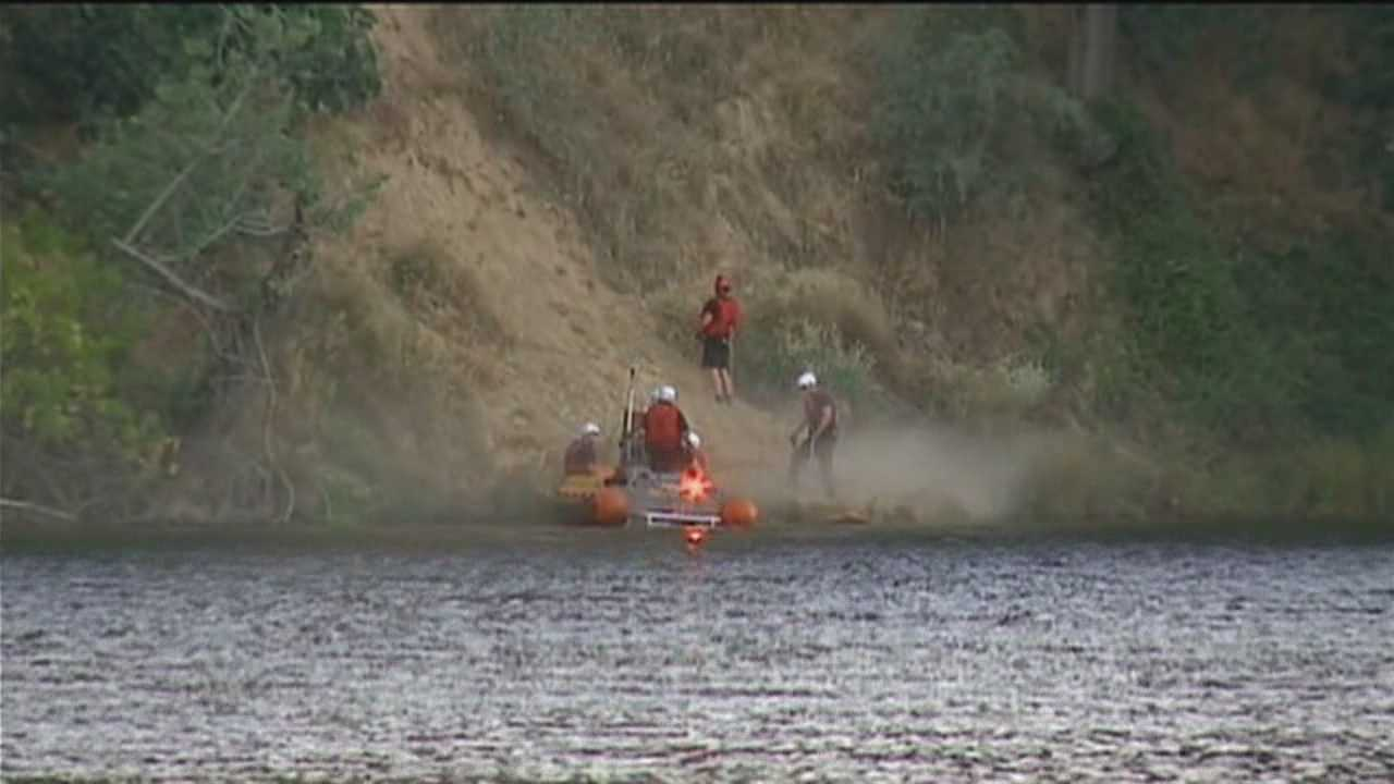 Rescue crews search along the American River in Sacramento County for man who may have been buried in a landslide.