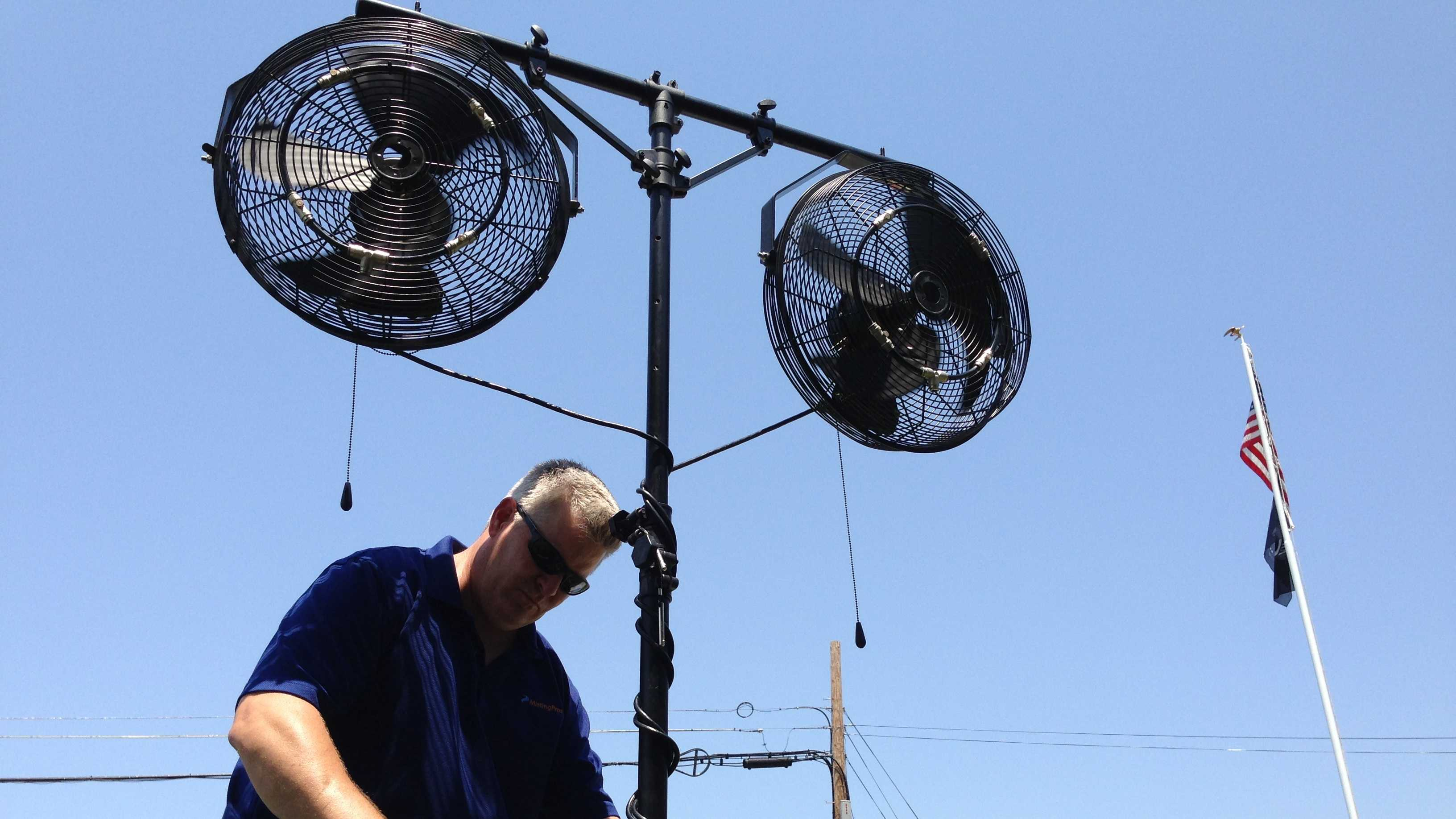 Dave Paul of Misting Pros shows one of the mist-producing fans that he rents.