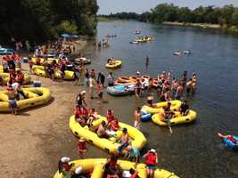 Fourth of July rafters take off in the American River from the Sunrise entrance. (July 4, 2013)