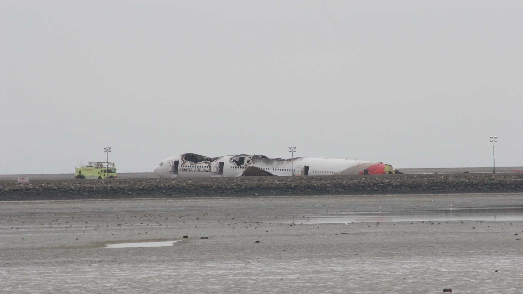 Asiana Airlines Flight 214 one day after its fatal crash at San Francisco International Airport