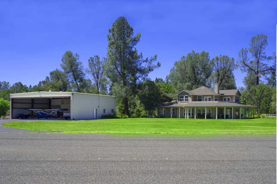 The airpark community is 2 acres and offers a large hanger, steps away from this custom home.