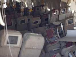 Oxygen masks dropped down when the plane made impact. The hard landing left a hole in the cabin. Some passengers were able to escape to safety through the hole.