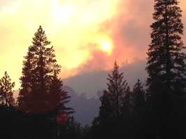 As of Monday night, a fire near Kyburz in El Dorado County had burned 160 acres with 0 containment. Crews are fighting the wildfire, which shut down Highway 50 in both directions earlier, near the El Dorado National Forest (July 8, 2013).