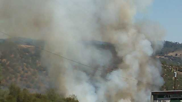 A fire burns near Foresthill Bridge in Auburn.