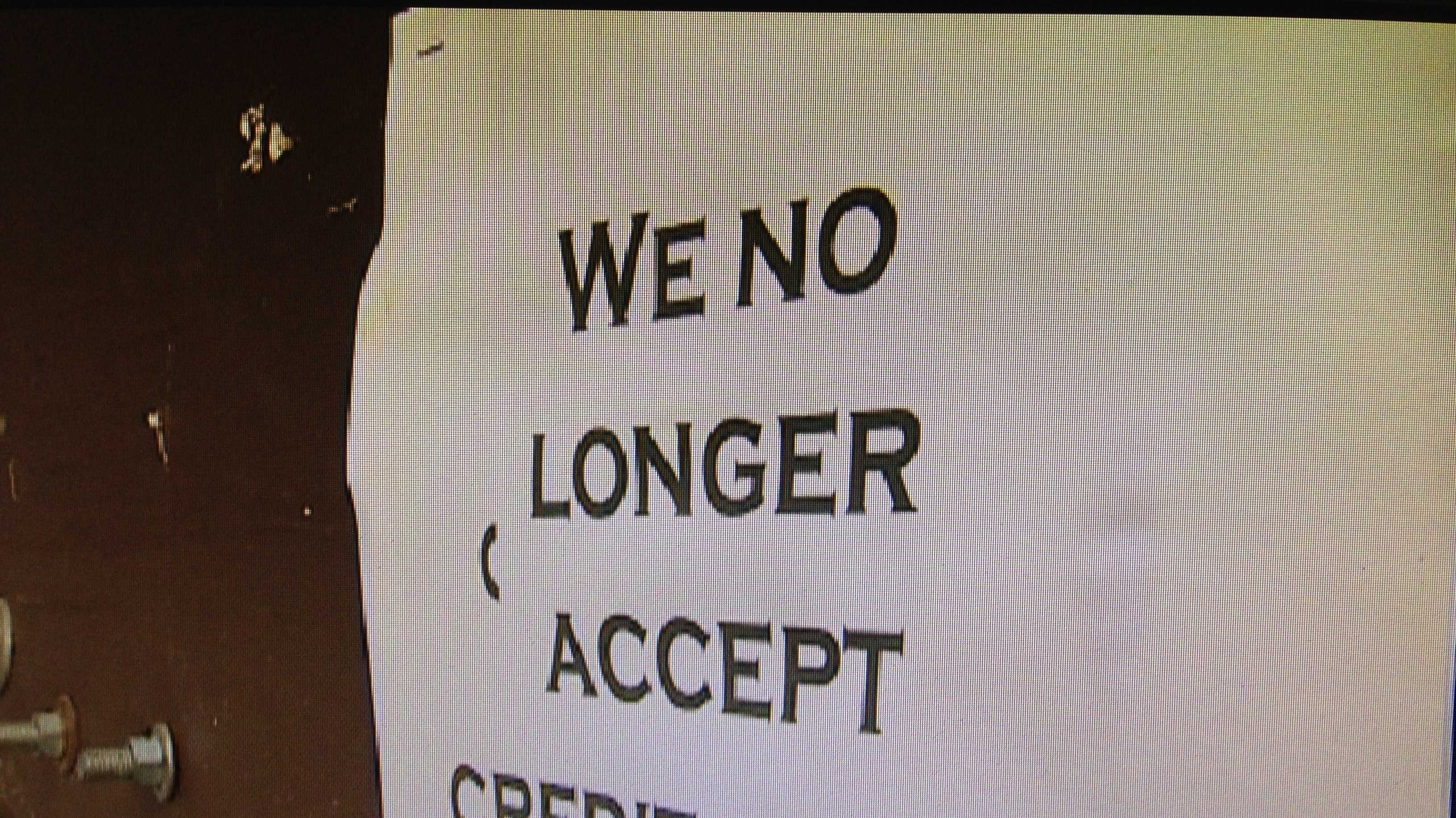 Here's a sign on the door to Wild Adventure Paintball that shows the facility won't take credit cards. At one point, said owner Debbie McEvers, she paid out nearly 20 percent of her profits to fees.