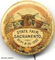 A button badge worn on the lapel in 1902 featured sheep, pigs, cattle and horses in addition to fruits and vegetables.