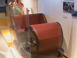 An old cart from a carnival ride is on display near the 5th Dimension Experience. The 5th Dimension Experience features a 3-D cinema, lasers and sounds.