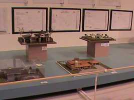 Models, complete with architectural drafts, on display.