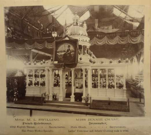 This photo shows an elaborate display featuring an authentic scale model of the State Capitol dome behind beautifully arranged glass canisters of all shapes.