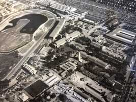 This aerial view shows the layout of the California State Fair in the 1930s at its Stockton Boulevard location, with a clear view of the Agricultural Building.