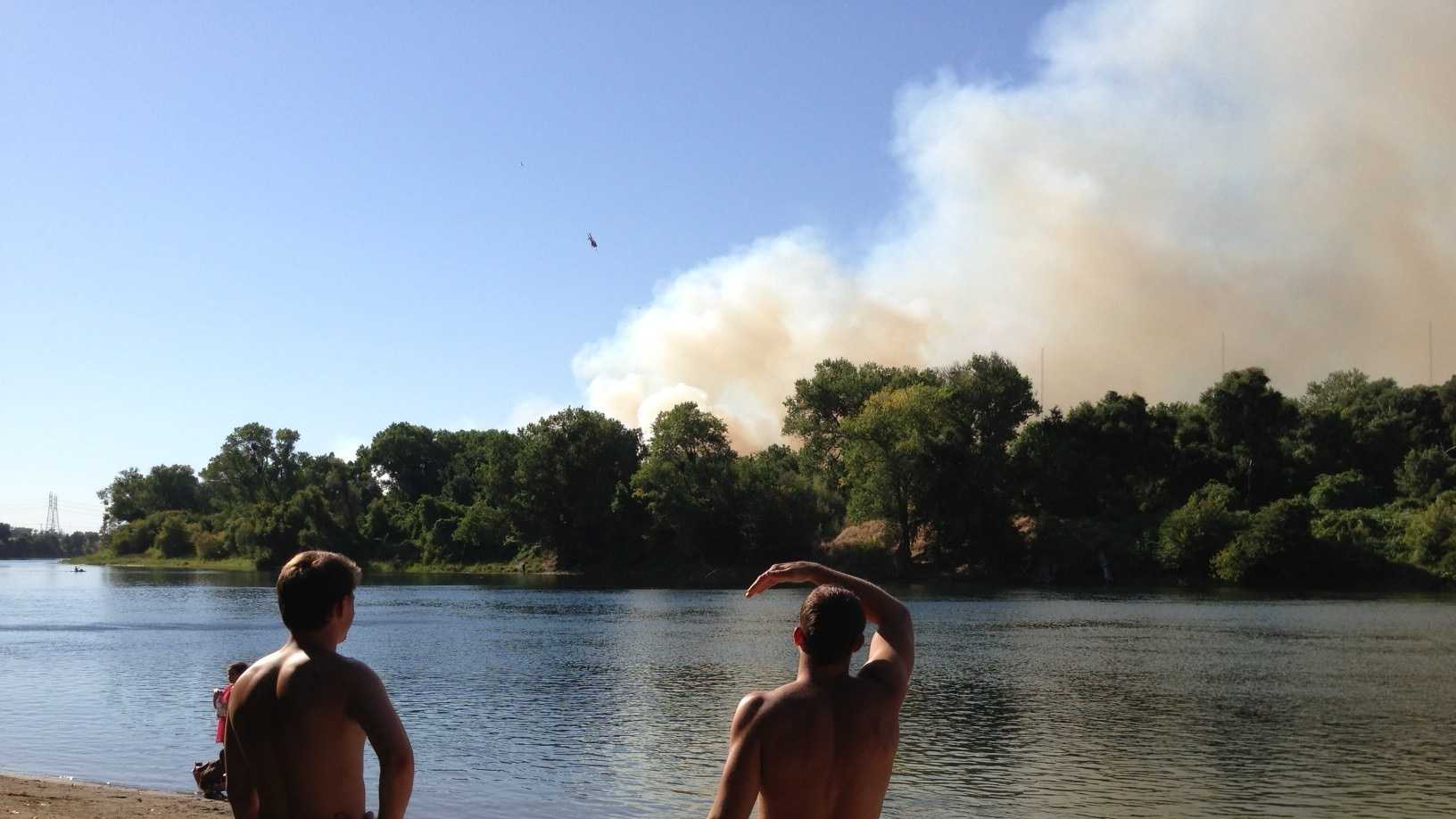 A grass fire broke out along Highway 160, north of downtown Sacramento.