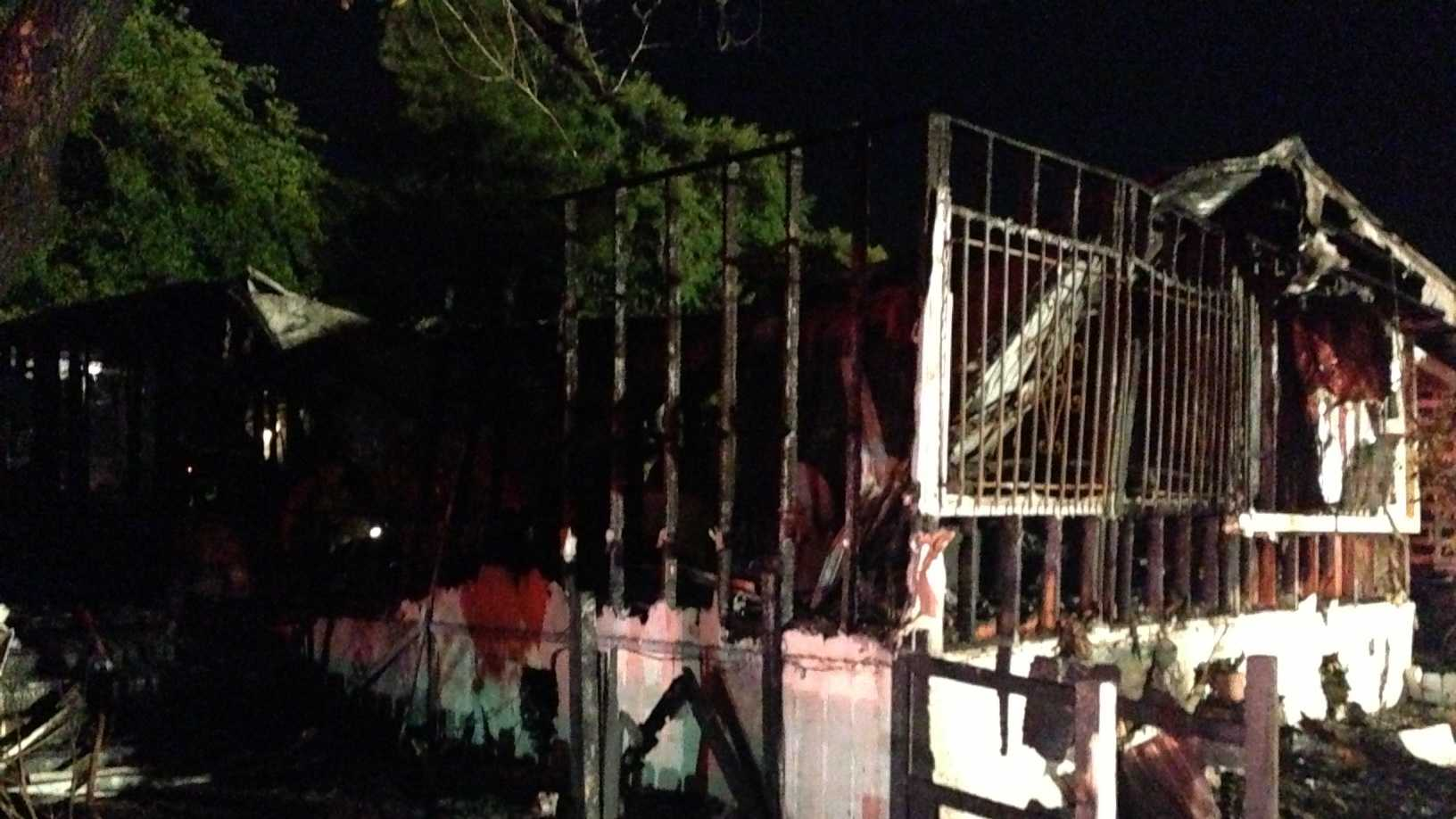 Two adults and three children escaped the blaze that threatened neighboring homes.