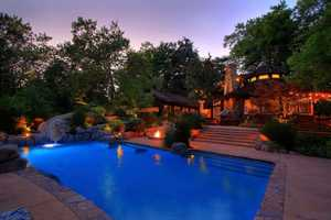 The home offers a pool and a handsome backyard landscape.