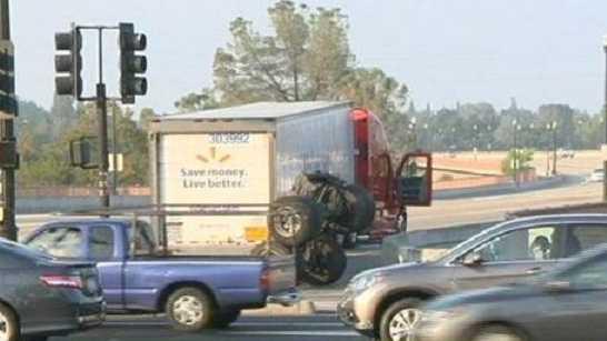 A big rig lost its rear wheel in a crash.