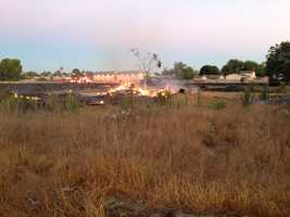 A 2-acre fire burned Thursday near Ceres, at Motsinger and Faith Home roads, in Stanislaus County. Early reports said one vacant home was destroyed by the flames (Aug. 1, 2013).