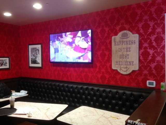 High-definition television screens are part of the new Farrell's design.
