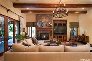 A tall, stone fireplace acts as the centerpiece for the family room.