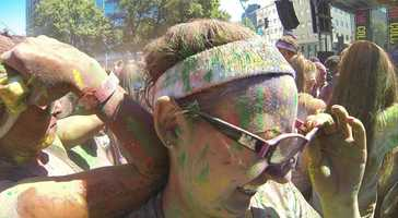 """The Color Run's slogan is that it is the """"Happiest 5k on the Planet"""" and paints the participants in shades of red, blue, yellow and green."""
