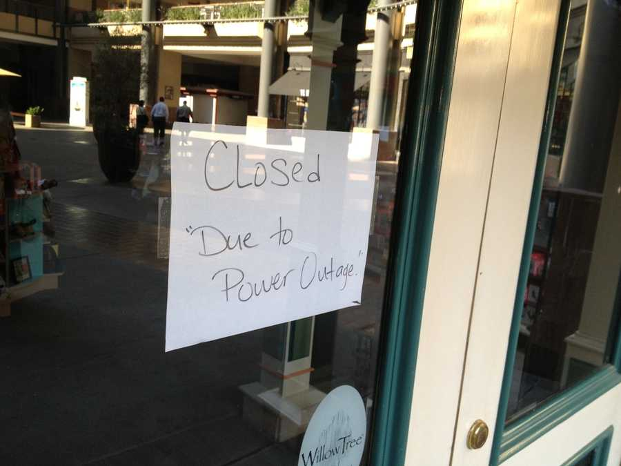 Managers were forced to hang handwritten signs on their doors to inform customers their businesses were closed due to Monday afternoon's power outage (Aug. 5, 2013).