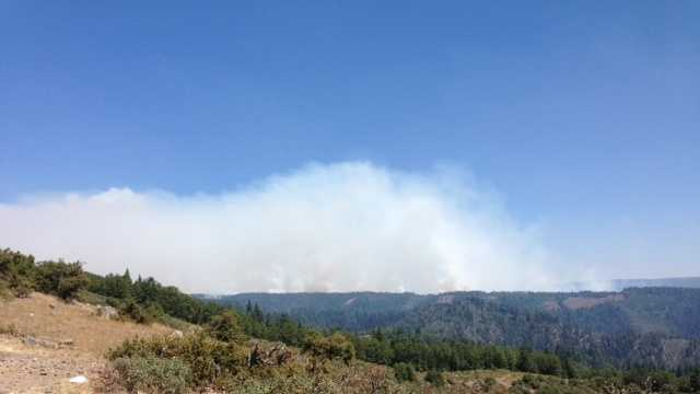 Smoke lifts off hills in Placer County.