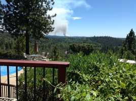 A wildfire in El Dorado County is threatening structures, the state fire agency said Friday afternoon.