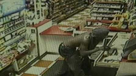 Surveillance video shows a man taking a cash register just after 4 a.m. Wednesday .