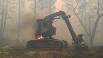 See photos from three fires, including the growing Rim Fire in Tuolumne County. For more wildfire photos, go to u local.
