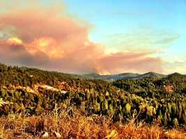 Smoke lifts of mountains as the Rim Fire continues to grow.