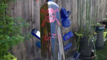 "A bottle in the yard is marked with a skull and crossbones and the word ""poizin."""