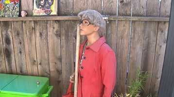 In the back yard, a mannequin holds a shovel, wears a wig and a has a coat similar to the one Dorothea Puente was wearing when she was arrested.