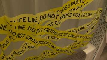 Holmes and Williams have crime tape covering their bathroom shower curtain.