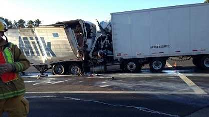 A semitruck crashed into the back of another truck.