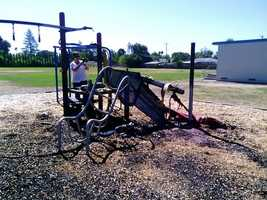 In July, one playground was burned to the ground and later hauled away.