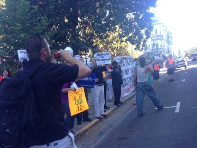 Current and former Walmart workers protested the retail giant's working conditions and hiring practices during a rally at Cesar Chavez Park in downtown Sacramento on Thursday.