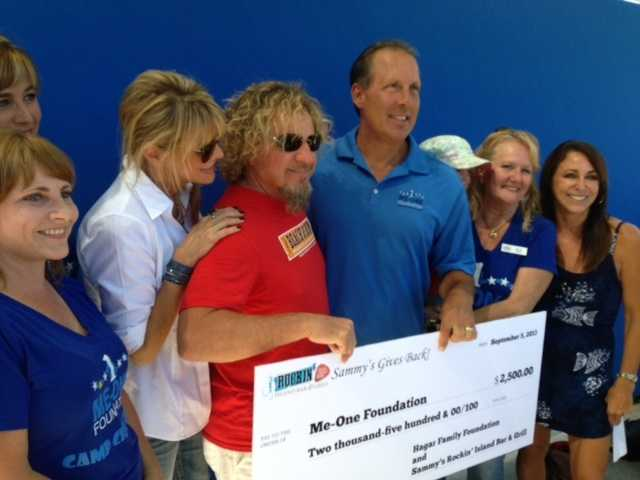 Rock and Roll Hall of Famer Sammy Hagar was in town in September, and swung by his restaurant in Roseville to donate money to two local charities.