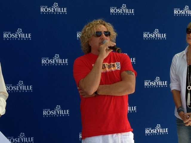 """Fans lined up in Roseville's town square to get autographs from the """"Red Rocker."""""""