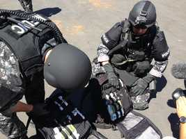 Roseville SWAT tactical medics display their specialized packs equipped to treat and rescue victims during a call.