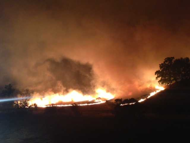 Officials said hot temperatures and wind gusts fueled the fire's spread (Sept. 9, 2013).