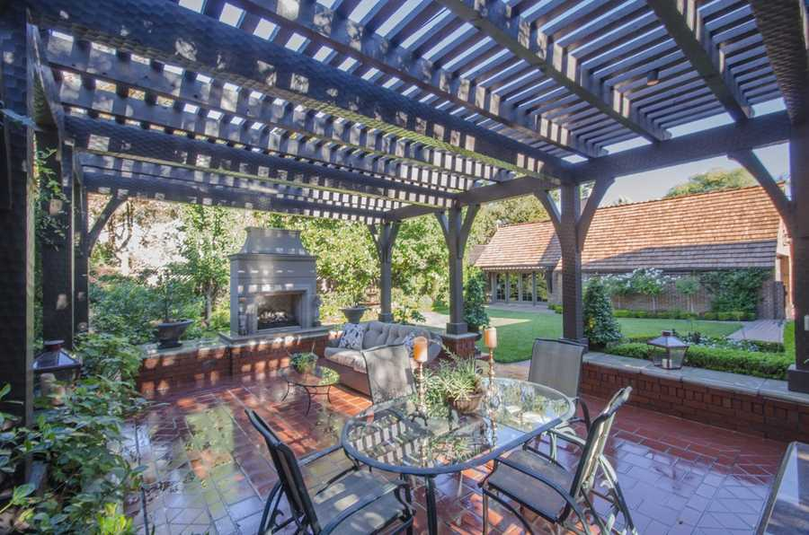 This area is perfect for outdoor entertainment, featuring an outdoor kitchen and fireplace.