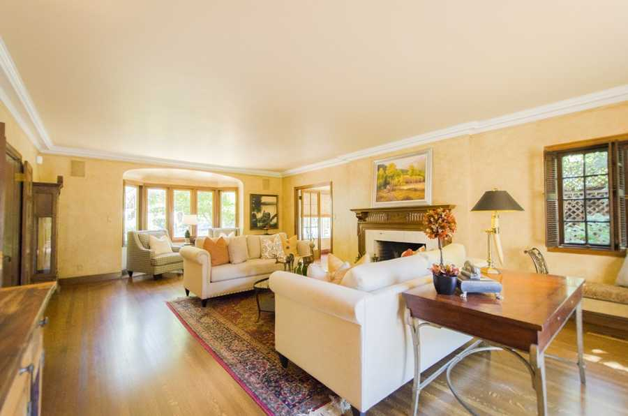 This home has plenty of room to entertain, including a grand living room, dining room, sunroom, full basement and media room.