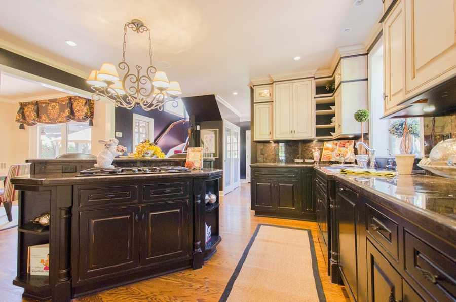 The kitchen features this island and rustic cabinetry.
